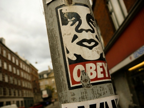 One of the stickers pasted on an urban space.